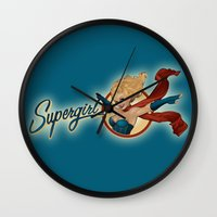 supergirl Wall Clocks featuring Supergirl Bombshell by Liquidsugar