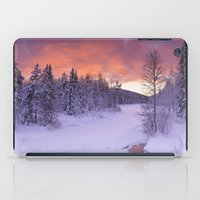 levi iPad Cases featuring III - Sunrise over a river in winter near Levi, Finnish Lapland by Sara Winter