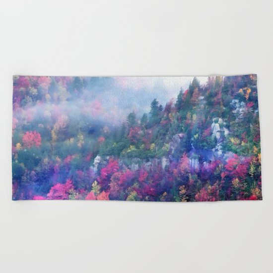 Fog over a colorful fall mountain forest Beach Towel