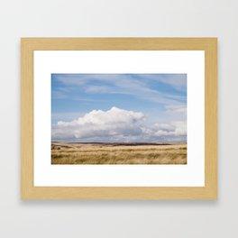 Blue sky and white clouds above sunlit moorland. Derbyshire, UK. Framed Art Print