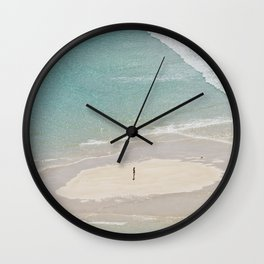 stranded in paradise Wall Clock