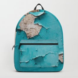 Blue old urban wall with cracked and grunge texture, weathered concrete structure close up view. Backpack