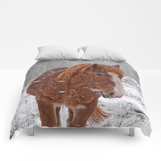 Horse in the snow Comforters
