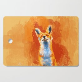 Happy Fox on an orange background Cutting Board