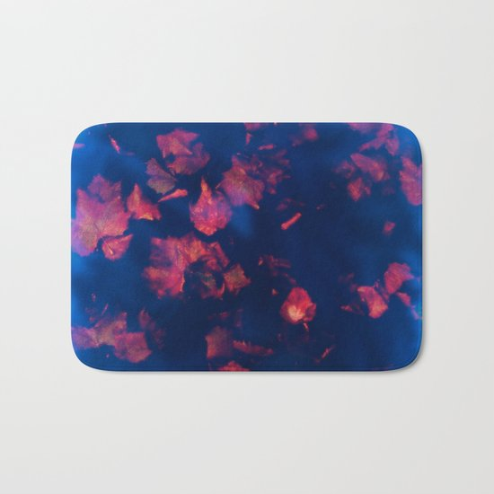 Rusty red falling leaves in dark blue water Bath Mat