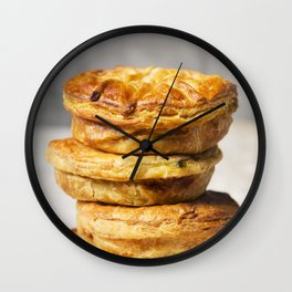 Stack of homemade meat pies on a rustic table Wall Clock