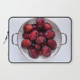 Some violet plums in a white glazed colander. Laptop Sleeve