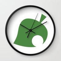 animal crossing Wall Clocks featuring Animal Crossing Leaf by Rebekhaart