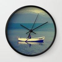 rowing Wall Clocks featuring rowing a boat in egirdir lake by gzm_guvenc
