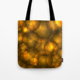 Glowing bronze soap circles and volume golden bubbles of air and water. Tote Bag