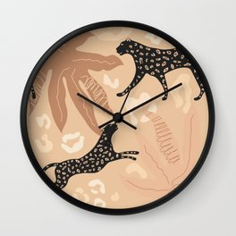 Leopards in jungle setting in caveman style Wall Clock