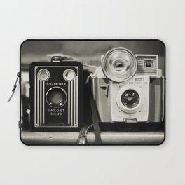 A pair of Kodak Brownies Laptop Sleeve