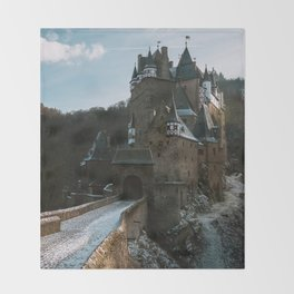 Fairytale Castle in a winter forest in Germany - Landscape and Architecture Throw Blanket