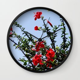 hibiscus tree on the blue sky Wall Clock
