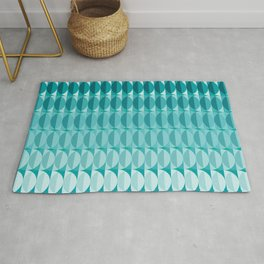 Leaves in the moonlight - a pattern in teal Rug