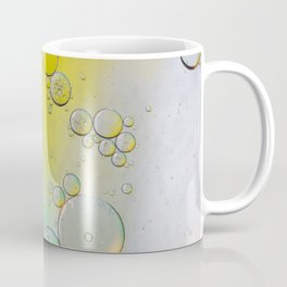 Oil drops in water. Defocused abstract psychedelic pattern image green, yellow and white gradient colored. DOF. Coffee Mug
