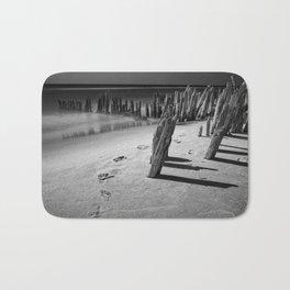 Trail of footprints on the beach at Kirk Park near Grand Haven on Lake Michigan Bath Mat