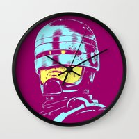 robocop Wall Clocks featuring Robocop (neon) by Liam Brazier