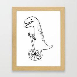 T-Rex riding bike Framed Art Print