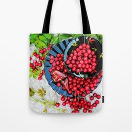 Cherries on black plates Tote Bag