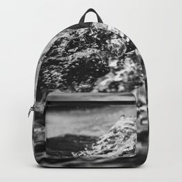 Running hand through the water, under the blue again black and white photograph / art photography Backpack