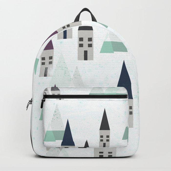 Village on winter Backpack