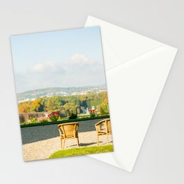 A couple of chairs on the top of a lookout watching the landscape I Stationery Cards