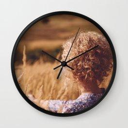 Girl in the field Wall Clock