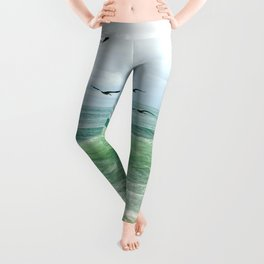Birds flying above ocean Leggings