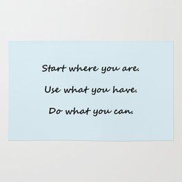 Start where you are - Arthur Ashe - light blue script Rug