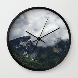 Clouds covering mountains Wall Clock