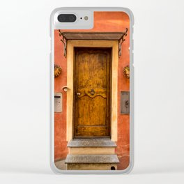 Wooden door of Tuscany with typical bright colors on its walls. Next to two small pots with flowers Clear iPhone Case