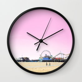 Santa Monica Pier with Ferries Wheel and Roller Coaster Against a Pink Sky Wall Clock