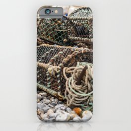 Fishing gear on a Norfolk beach iPhone Case