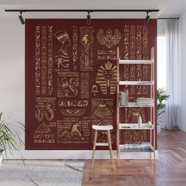 Egyptian hieroglyphs and symbols gold on red leather Wall Mural
