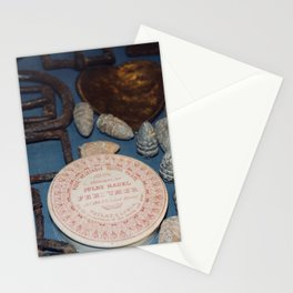 Belt buckles, iron musket bullets and perfume Stationery Cards