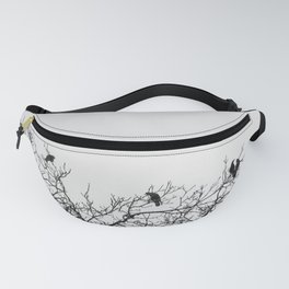 A murder of crows sitting in a tree Fanny Pack