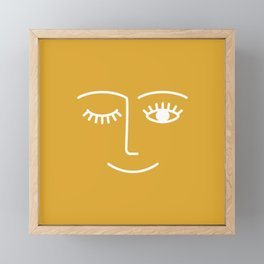 wink / mustard Framed Mini Art Print