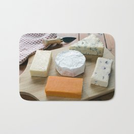 Cheese Board Selection on a Wooden Table Bath Mat