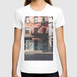 GRAY BIKE ON GRAY CONCRETE BUILDING T-shirt