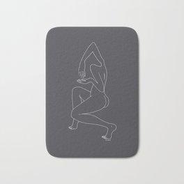 Minimalist Woman in Black Bath Mat