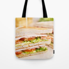 Club sandwich on a rustic table in bright light Tote Bag