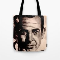 james bond Tote Bags featuring Sean Connery as James Bond by Caroline Ward