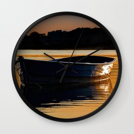 Rowing boat at sunset. Wall Clock