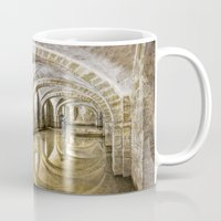mandie manzano Mugs featuring Winchester Cathedral Crypt by Alice Gosling