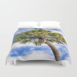 Palm Tree Against a Blue Sky Duvet Cover