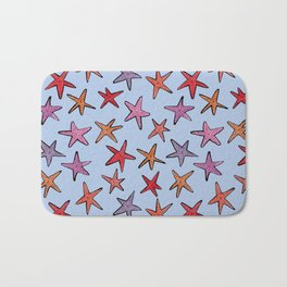 Starfishes in clear water Bath Mat