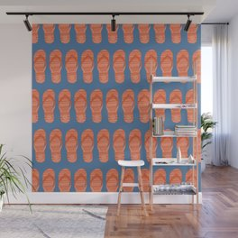 Orange flip flop shoes on a blue background. Wall Mural