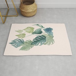 Minimalist watercolor tropical monstera leaves in blushpink and emerald Rug