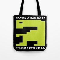 video game Tote Bags featuring Worst Video Game Ever by Silvio Ledbetter